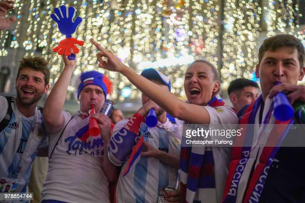 Russian football fans celebrate their national team's 31 win over Egypt on Nikolskaya Street near Red Square on June 19 2018 in Moscow Russia