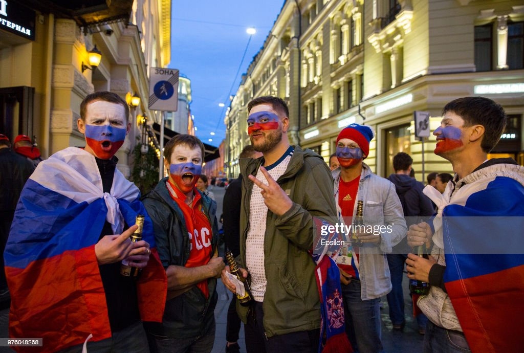 Russian football fans cheer at Moscow downtown on June 14, 2018 in Moscow, Russia.