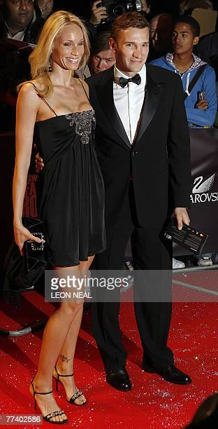 Russian footballer and member of the Chelsea squad Andriy Shevchenko and wife Kristen Pazik arrive at the Fashion Rocks for the Princes Trust event...