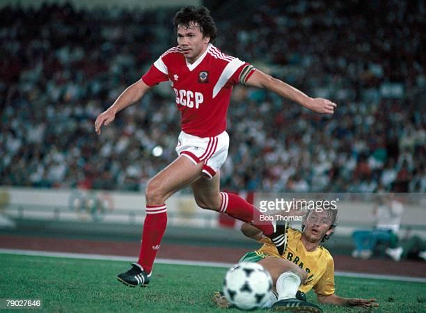Russian footballer Viktor Losev beats Brazilian footballer Ferreira during the final of the football tournament between Brazil and the eventual gold...