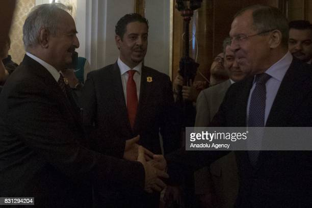 Russian Foreign Minister Sergei Lavrov and Libyan National Army Commander Khalifa Haftar shake hands before their meeting in Moscow Russia on August...