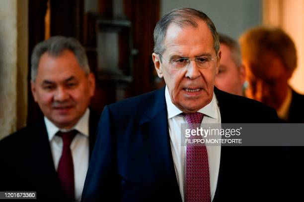Russian Foreign Minister Sergei Lavrov and Russian Defence Minister Sergei Shoigu arrive for a press conference following an Italy - Russia meeting...