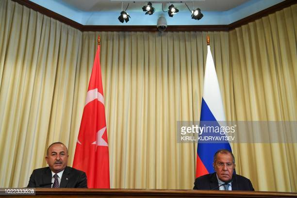 Russian Foreign Minister Sergei Lavrov and Turkish counterpart Mevlut Cavusoglu give a joint press conference after their meeting in Moscow on August...