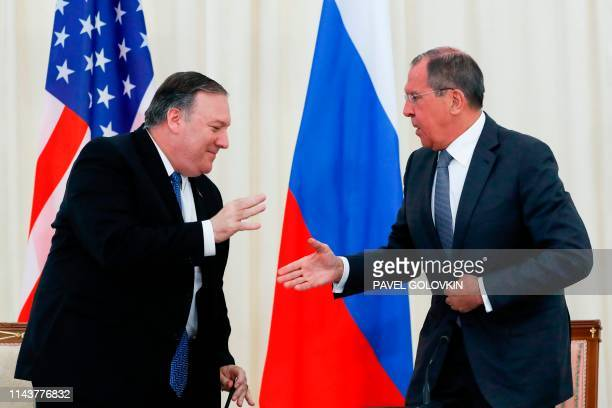 Russian Foreign Minister Sergei Lavrov and US Secretary of State Mike Pompeo shake hands at the end of a joint press conference following their talks...