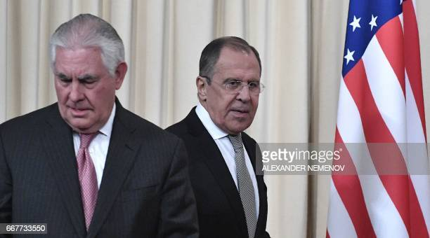 Russian Foreign Minister Sergei Lavrov and US Secretary of State Rex Tillerson arrive to attend a press conferece after their talks in Moscow on...