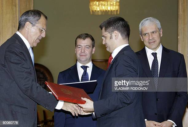 Russian Foreign Minister Sergei Lavrov exchanges documents with Serbian Foreign Minister Vuk Jeremic in Belgrade on October 20 2009 as Russian...