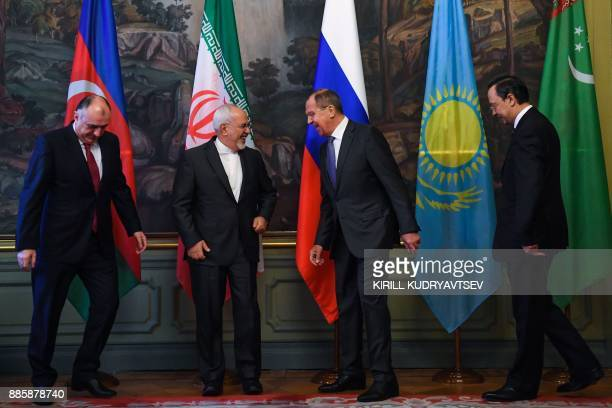 Russian Foreign Minister Sergei Lavrov jokes with his Iranian counterpart Mohammad Javad Zarif as Foreign Ministers of Azerbaijan and Kazakhstan...