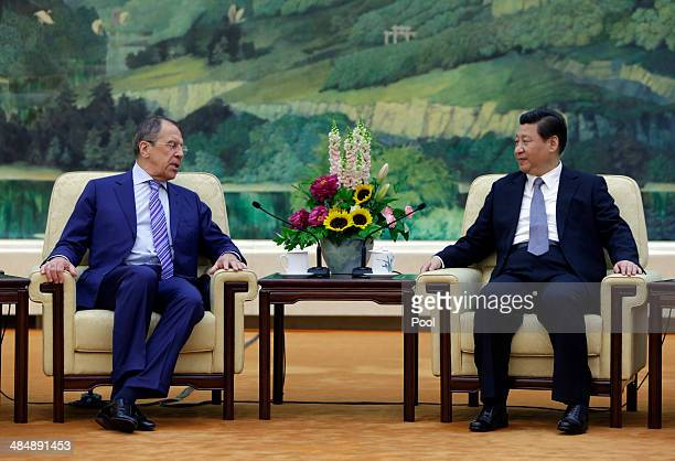Russian Foreign Minister Sergei Lavrov meets with China's President Xi Jinping at the Great Hall of the People on April 15 2014 in Beijing China...