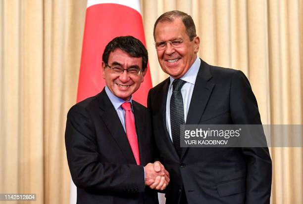 Russian Foreign Minister Sergei Lavrov shakes hands with Japanese Foreign Minister Taro Kono after their news conference in Moscow on May 10, 2019.