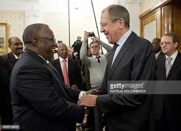 Russian Foreign Minister Sergei Lavrov shakes hands with Sudan's deputy president Hassabo Mohammed Abdel Rahman during a meeting in Moscow on October...