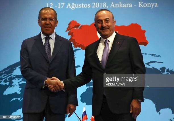 Russian Foreign Minister Sergei Lavrov shakes hands with Turkish Foreign Affairs minister Mevlut Cavusoglu during the 10th Ambassadors' conference in...