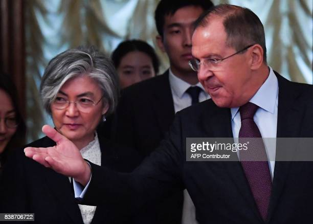 Russian Foreign Minister Sergei Lavrov shows the way to his South Korean counterpart Kang Kyung-wha during a meeting in Moscow on August 25, 2017. /...