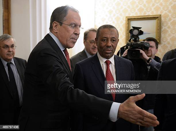Russian Foreign Minister Sergei Lavrov shows the way to Libyan Prime Minister Abdullah al-Thani during their meeting in Moscow on April 15, 2015. AFP...