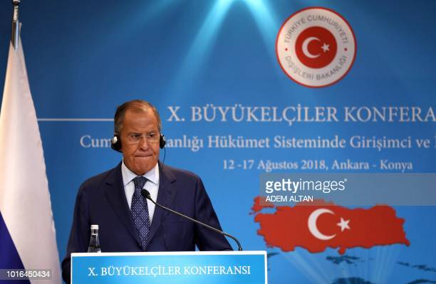 Russian Foreign Minister Sergei Lavrov speaks during a joint press conference following a meeting with Turkey's counterpart in Ankara on August 14...