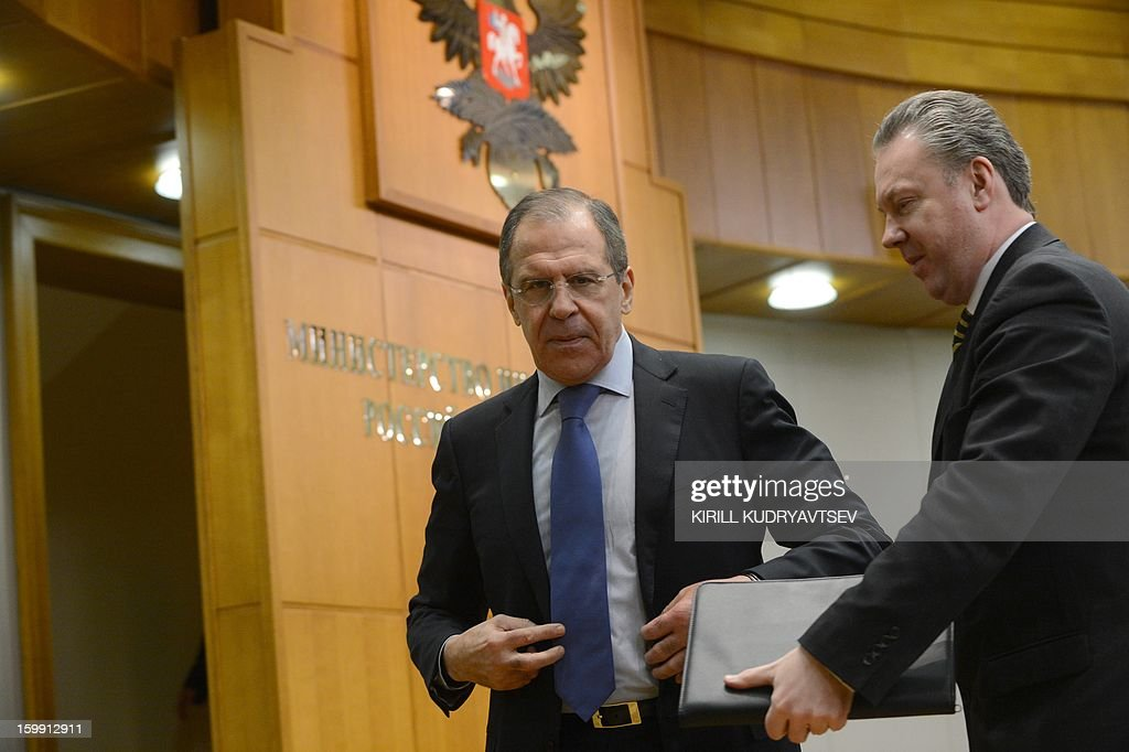 Russian Foreign Minister Sergei Lavrov (L) speaks with Foreign Ministry spokesman Alexander Lukashevich (R) after holding his traditional start-of-year press conference in Moscow, on January 23, 2013, with attention focused on Russia's position on the raging conflict in Syria.