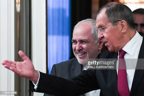 Russian Foreign Minister Sergei Lavrov welcomes his Iranian counterpart Mohammad Javad Zarif during a meeting in Moscow on September 2, 2019.