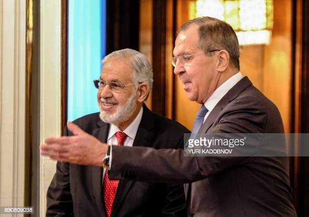 Russian Foreign Minister Sergei Lavrov welcomes his Libyan counterpart Taha Siala for their meeting in Moscow on December 12, 2017. / AFP PHOTO /...