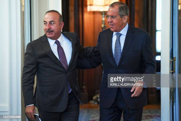 Russian Foreign Minister Sergei Lavrov welcomes his Turkish counterpart Mevlut Cavusoglu prior to their meeting in Moscow on August 24 2018