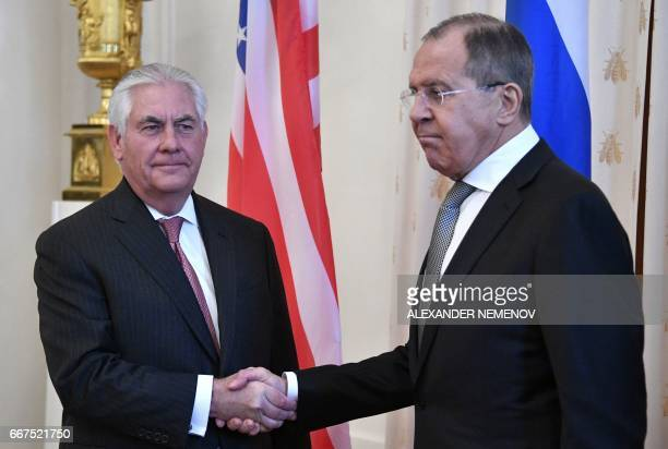 TOPSHOT Russian Foreign Minister Sergei Lavrov welcomes US Secretary of State Rex Tillerson before a meeting in Moscow on April 12 2017 Tillerson...
