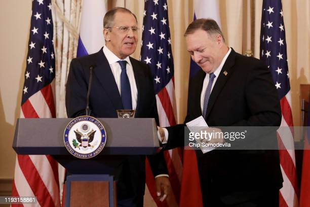 Russian Foreign Minister Sergey Lavrov and US Secretary of State Mike Pompeo shake hands at the conclusion of a joint news conference in the Franklin...