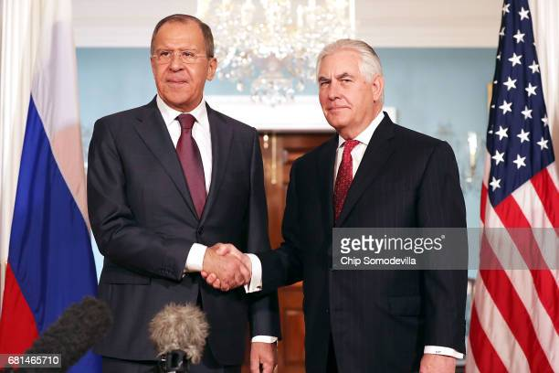 Russian Foreign Minister Sergey Lavrov and U.S. Secretary of State Rex Tillerson shake hands in the Treaty Room before heading into meetings at the...