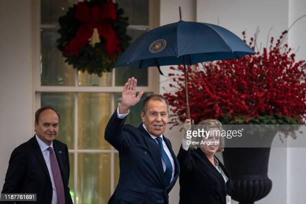 Russian Foreign Minister Sergey Lavrov exits the West Wing of the White House following a Oval Office meeting with U.S. President Donald Trump on...