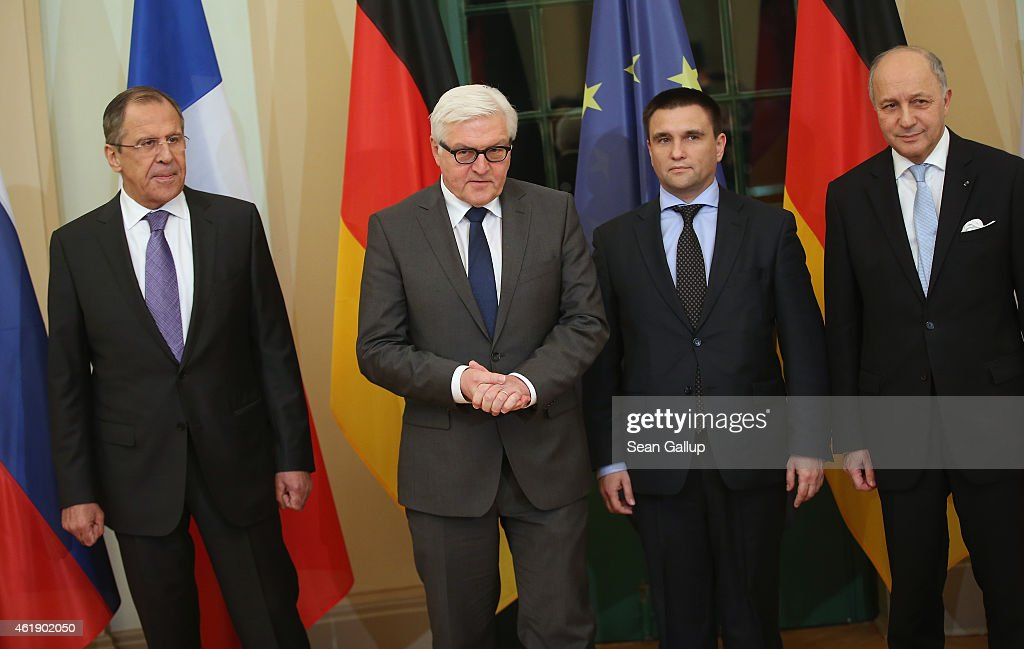 Russian Foreign Minister Sergey Lavrov, German Foreign Minister Frank-Walter Steinmeier, Ukrainian Foreign Minister Pavlo Klimkin and French Foreign Minister Laurent Fabius arrive to discuss the ongoing conflict in eastern Ukraine at Villa Borsig on January 21, 2015 in Berlin, Germany. The four men are meeting as fighting between the Ukrainian Army and Russian-backed separatists in the Donbas region of eastern Ukraine has increased in the last few weeks.