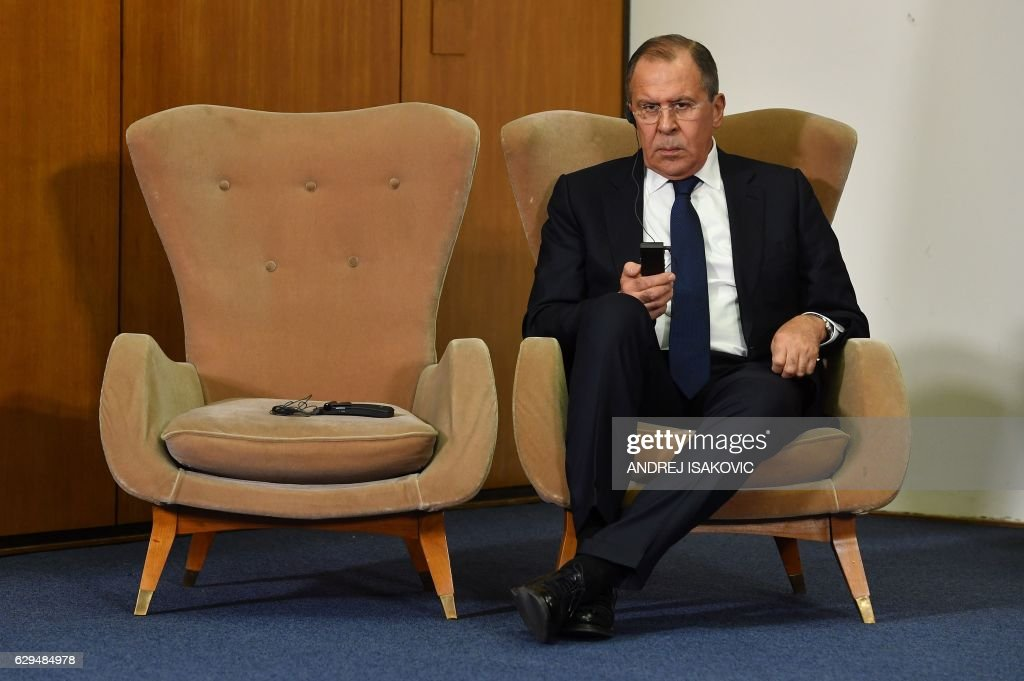 TOPSHOT - Russian Foreign Minister Sergey Lavrov listens to his Serbian counterpart during a press conference after the BSEC session in Belgrade on December 13, 2016. Lavrov arrived to Serbia on December 12 to discuss collaboration between Russia and Serbia and the situation in the Balkans with Serbian leaders and to took part in a session of the Council of Foreign Ministers of the Black Sea Economic Cooperation Organization (BSEC). / AFP / ANDREJ