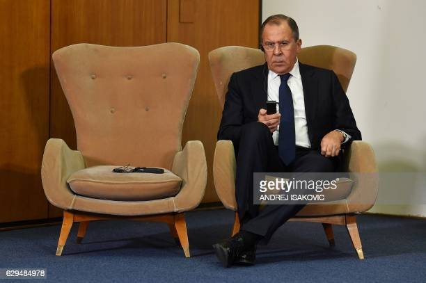 TOPSHOT Russian Foreign Minister Sergey Lavrov listens to his Serbian counterpart during a press conference after the BSEC session in Belgrade on...