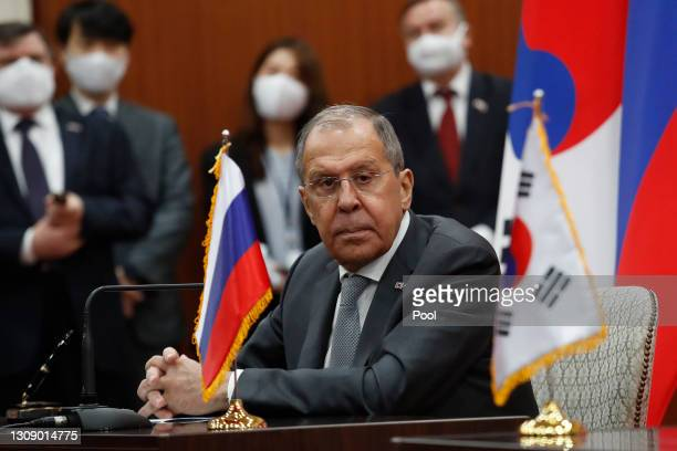 Russian Foreign Minister Sergey Lavrov listens to South Korean Foreign Minister Chung Eui-yong's announcement during a joint announcement at the...