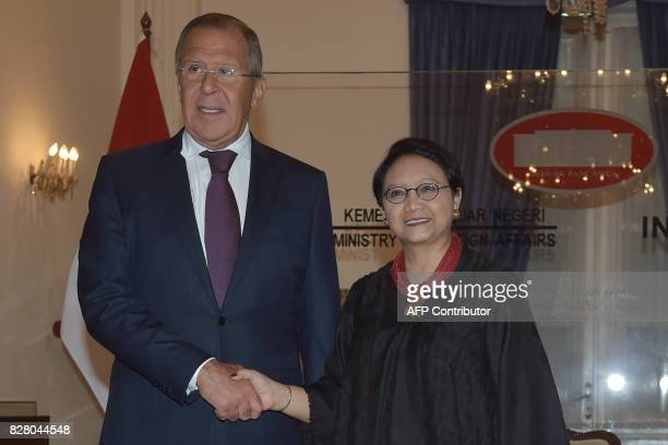 Russian Foreign Minister Sergey Lavrov shakes hands with his Indonesian counterpart Retno Marsudi prior to their meeting in Jakarta on August 9 2017...
