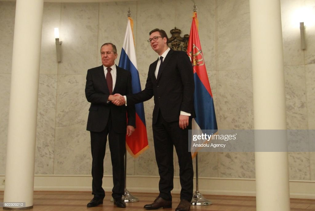 Russian Foreign Minister Sergey Lavrov (L) shakes hands with Serbian President Aleksandar Vucic (R) as they pose for a photo ahead of their meeting in Belgrade, Serbia on February 21, 2018.