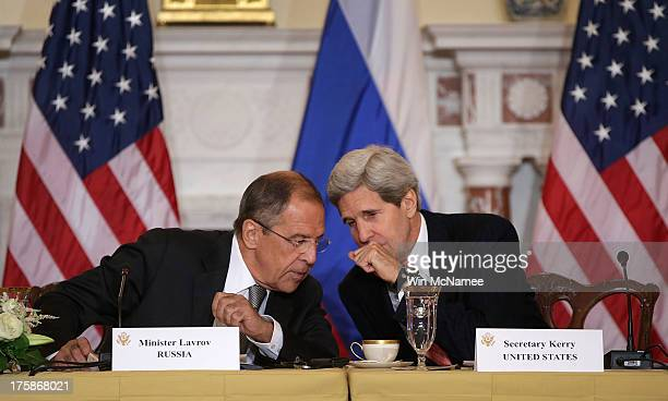 Russian Foreign Minister Sergey V Lavrov talks with US Secretary of State John Kerry during a meeting at the US State Department on August 9 2013 in...