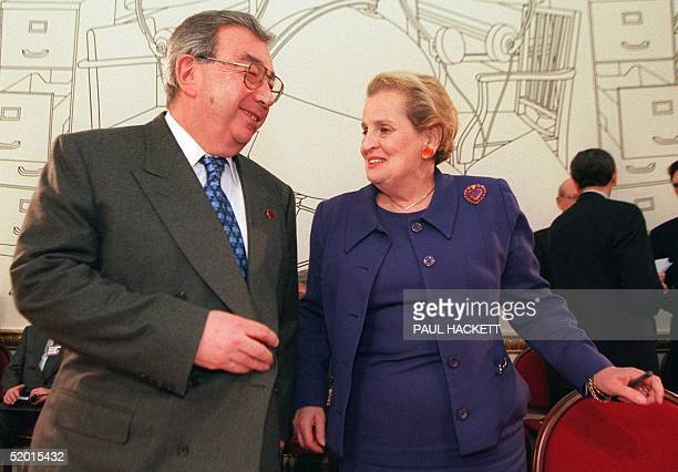 Russian Foreign Minister Yevgeny Primakov jokes 12 June with his US counterpart Madeleine Albright prior to the start of a Group of Eight ministerial...