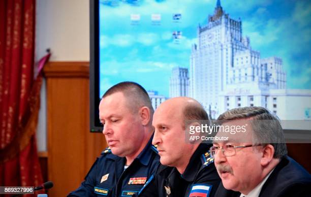 Russian Foreign Ministry's security and disarmament department head Mikhail Ulyanov along with other attendees hold a briefing to present analysis of...