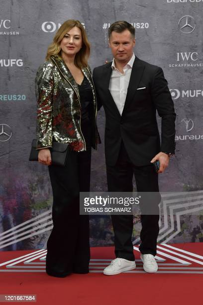 Russian former gymnast Alexei Nemov and his wife Galina pose on the red carpet prior to the 2020 Laureus World Sports Awards ceremony in Berlin on...