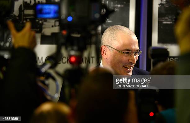 Russian former oil tycoon and Kremlin critic Mikhail Khodorkovsky speaks during a press conference at the Wall Museum at Checkpoint Charlie on...