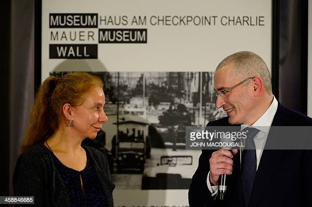 Russian former oil tycoon and Kremlin critic Mikhail Khodorkovsky addresses a press conference next to Wall Museum's director Alexandra Hildebrandt...