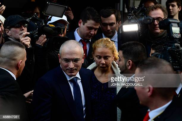 Russian former oil tycoon and Kremlin critic Mikhail Khodorkovsky is accompanied by the Wall Museum's director Alexandra Hildebrandt as he leaves...