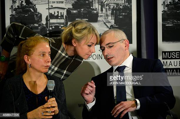 Russian former oil tycoon and Kremlin critic Mikhail Khodorkovsky talks with his representative for public relations Olga Pispanen and the Berlin...