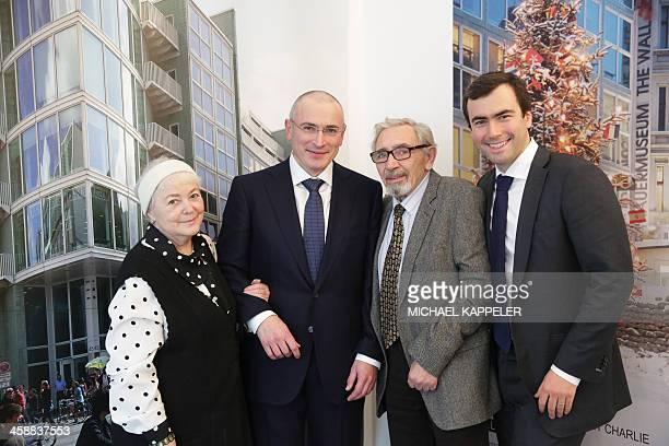 Russian former oil tycoon Mikhail Khodorkovsky stands next to his mother Marina Khodorkovsky and his father Boris Khodorkovsky and his son Pavel...