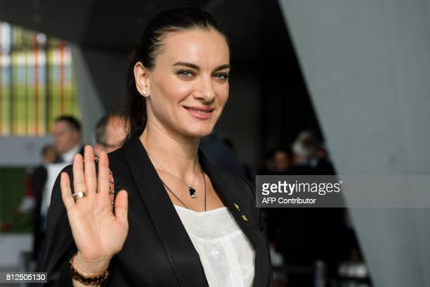 Russian former pole vaulter legend Yelena Isinbayeva waves upon her arrival for Los Angeles and Paris 2014 bid presentations before the International...