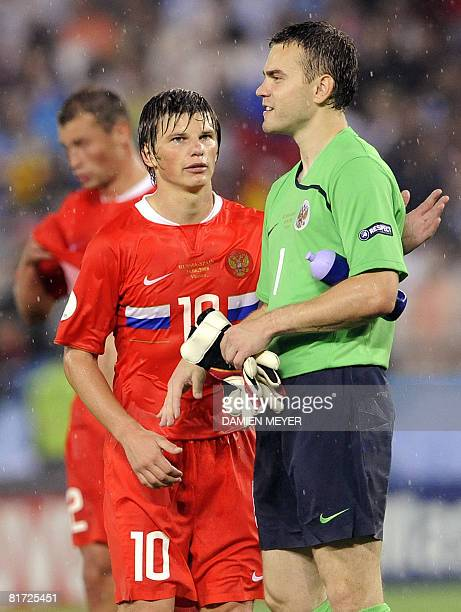Russian forward Andrei Arshavin and Russian goalkeeper Igor Akinfeev react after the Euro 2008 championships semifinal football match Russia vs Spain...
