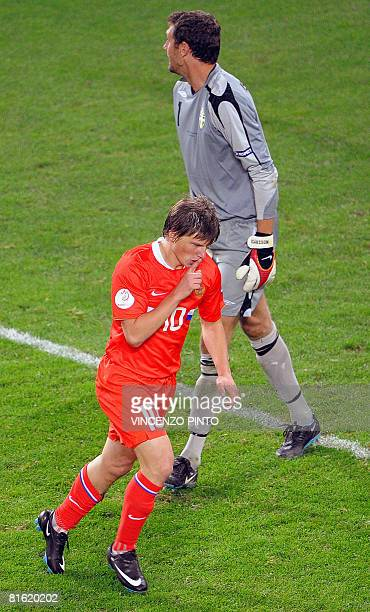 Russian forward Andrei Arshavin celebrates after scoring a goal in front of Swedish goalkeeper Andreas Isaksson during the Euro 2008 Championships...