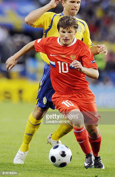 Russian forward Andrei Arshavin fights for the ball in front of Swedish midfielder Anders Svensson during the Euro 2008 Championships Group D...