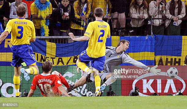 Russian forward Andrei Arshavin scores a goal as Swedish goalkeeper Andreas Isaksson misses the ball during the Euro 2008 Championships Group D...