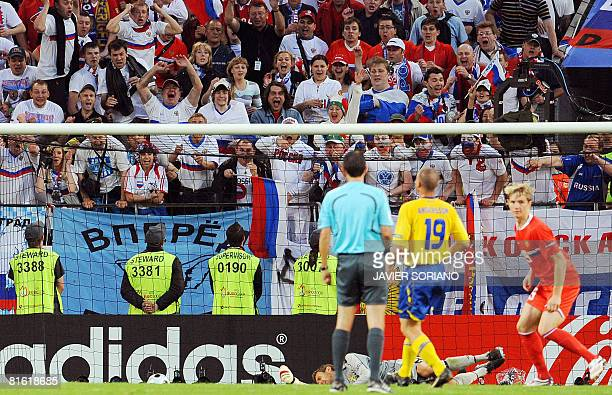 Russian forward Roman Pavlyuchenko celebrates after scoring a goal in front of Swedish goalkeeper Andreas Isaksson during the Euro 2008 Championships...