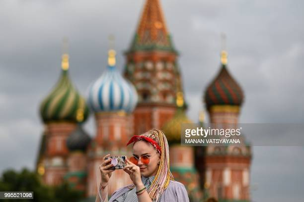 A Russian girl takes pictures with her mobile phone at Red Square in Moscow on July 10 on the eve of the Russia 2018 World Cup semifinal football...