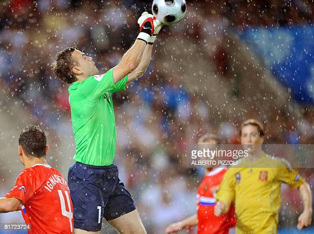 Russian goalkeeper Igor Akinfeev defkects the ball during the Euro 2008 championships semifinal football match Russia vs Spain on June 26 2008 at...