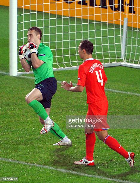 Russian goalkeeper Igor Akinfeev grabs the ball next to Russian defender Sergei Ignashevich during the Euro 2008 championships semifinal football...